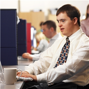 Person with Down syndrome working at computer